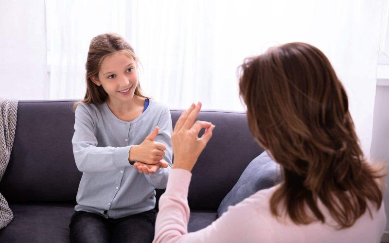 Girl learning sign language