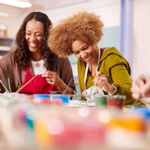 Two women attending art class